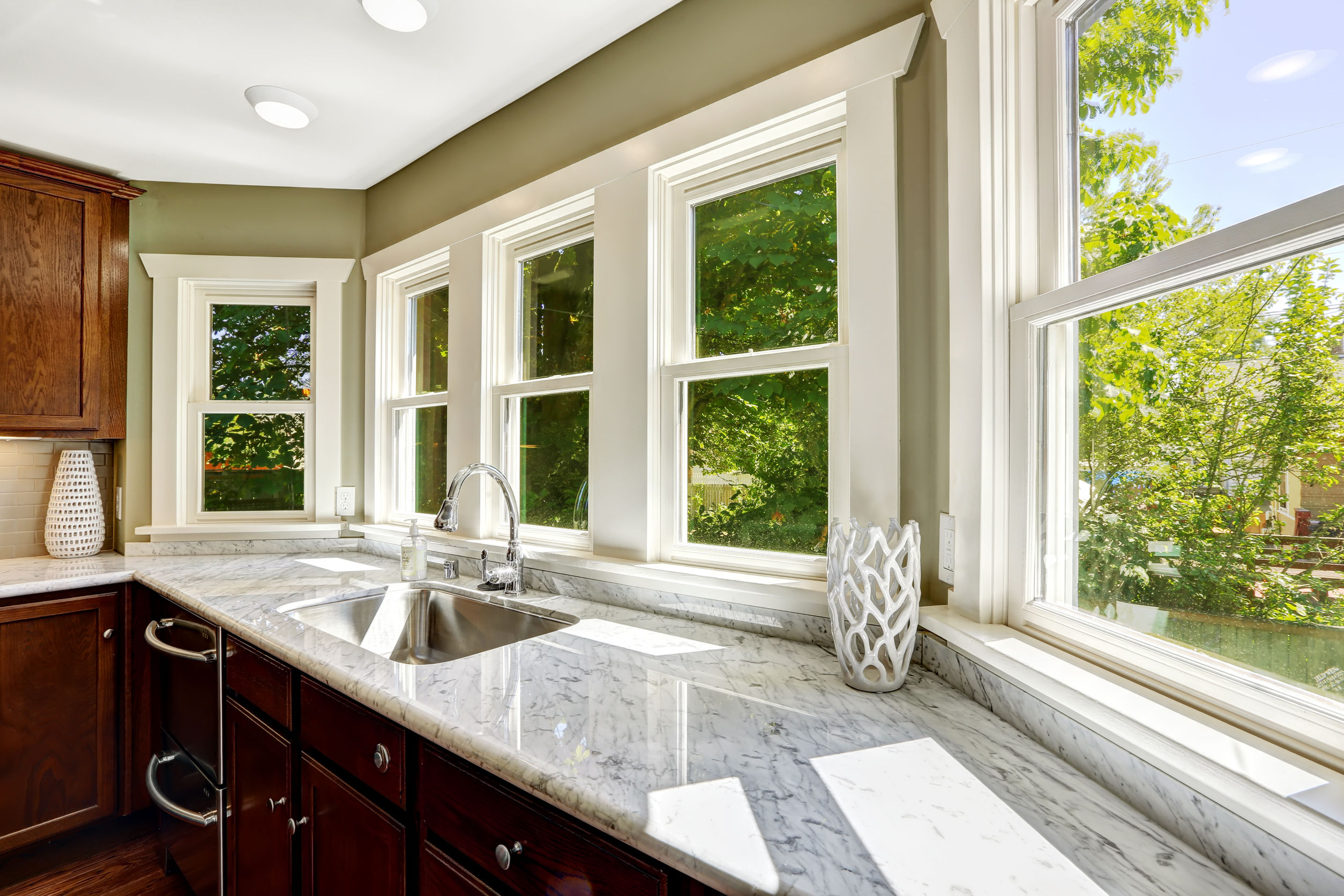 31386060 - beautiful kitchen cabinet with marble top and steel sink